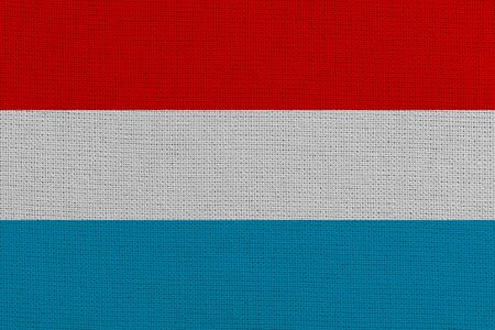 luxembourg fabric flag. Patriotic background. National flag of luxembourg