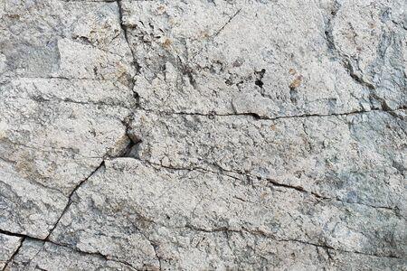 Cracked stone texture. White stone background