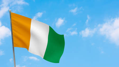 Cote d'ivoire - Ivory Coast flag on pole. Blue sky. National flag of Cote d'ivoire - Ivory Coast