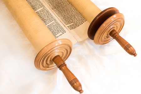 scroll: The Hebrew handwritten Torah, on a synagogue alter, illustrating Jewish holidays, during fests. Half open