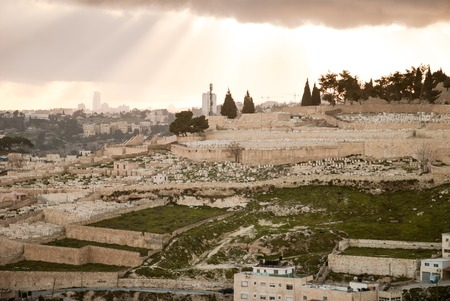 Panorama of Jerusalem from the Mount of Olives, with cloud in the sky and beautiful rays of sun