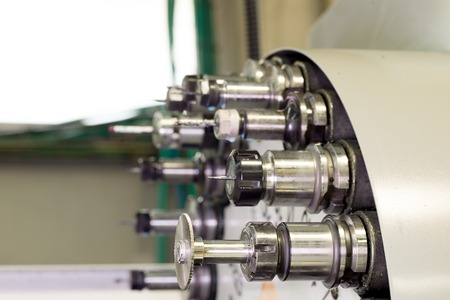 affixment: CNC industrial metal work bore cutting tool on automated lathe changer carousel Stock Photo