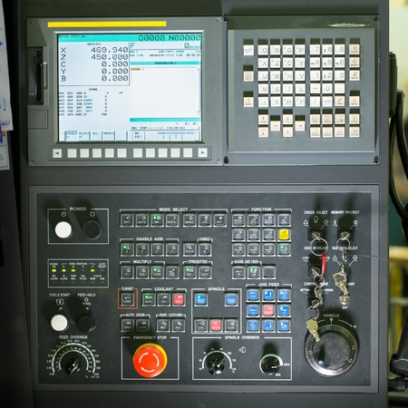 Front view on cnc milling machine control panel with display