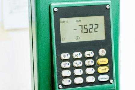 diameters: Industrial digital automatic height gauge equipment tool monitor with keyboard displaying measures on screen