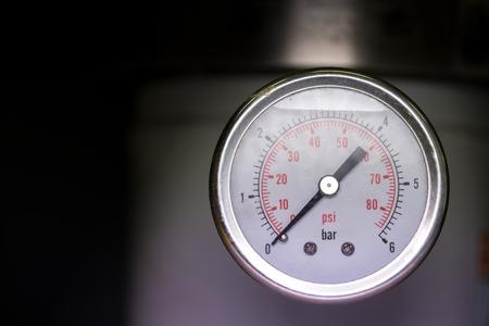 manometer: manometer turbo pressure meter gauge in pipes oil plant with liquid inside Stock Photo