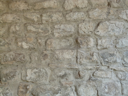 Stone Wall Photo. Old Stones Background. Stone medieval wall. real medieval masonry