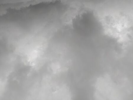 Sky with gray clouds, background, thunderclouds, unstable changeable weather. Sky before the rain. Stock Photo