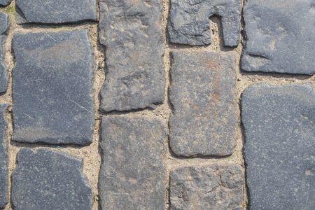 Fragment of a old cobblestone pavement. Horizontal orientation, selective focus. Stok Fotoğraf