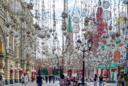 Moscow, Russia - June 25, 2020. View of Nikolskaya Street in the historic center of the city decorated with garlands and other elements of decor. Horizontal orientation, selective focus. Редакционное