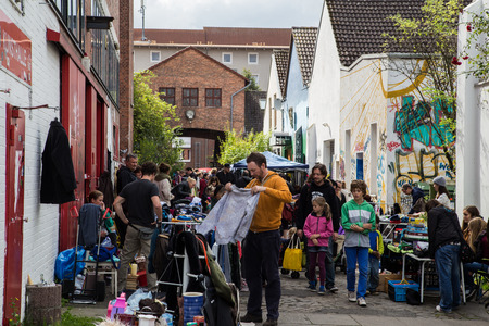 rummage: Hanover, Germany - September 14, 2014: People buying and selling things on the weekly flea market at the Kulturhaus Faust in Hanover, Germany. Editorial