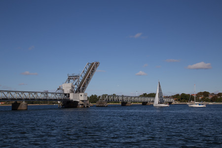 Aalborg, Denmark - September 21, 2014: Drawbridge at Aalborg Limfjord is opened to let a sailing boat pass through.