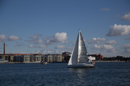 Aalborg, Denmark - September 21, 2014: Sailing boat on the Limfjord river on a beatiful autumn day. Editorial