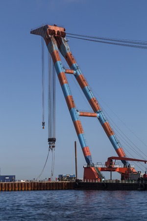 gigantic: Copenhagen, Denmark - August 6, 2015: Photograph of a gigantic swimming construction crane at the newly created area Nordhavn. Editorial