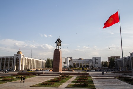flagpole: Bishkek, Kyrgyzstan - September 30, 2014: Ala-Too Square in Bishkek, Kyrgyzstan with the Erkindik statue and the officiel state flagpole. Editorial