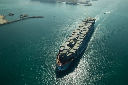 Aerial view of a cargo container ship in Dubai, UAE.