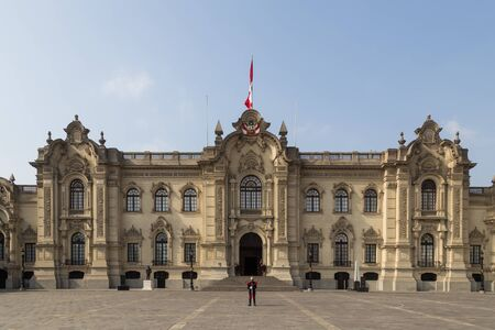 Lima, Peru - September 5, 2015: The Government Palace in the city centre with guards standing in front of it. Editorial