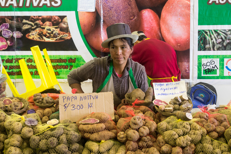 Lima, Peru - September 11, 2015: Woman selling different sorts of potatoes at the annual food festival Mistura.
