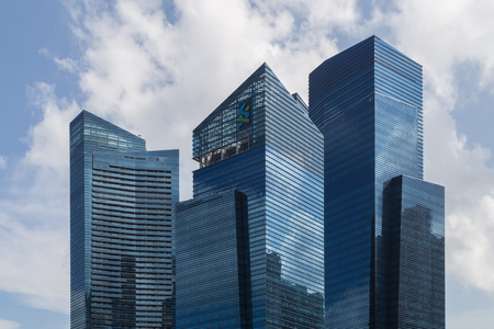 glass building: Singapore - January 30, 2015: Closeup photograph of skyscrapers in the central business district. Editorial