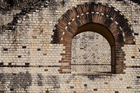 augusta: A Photograph of a window detail of the old Roman theater at Augusta Raurica in Kaiseraugst, Switzerland.