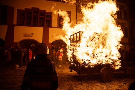 fasnacht: Liestal, Switzerland - March 09, 2014: Photograph of a burning cart at the traditional fire parade Chienbaese for Fasnacht.