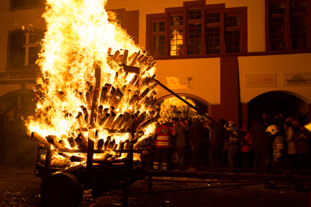 Liestal, Switzerland - March 09, 2014: Photograph of a burning cart at the traditional fire parade Chienbaese for Fasnacht.