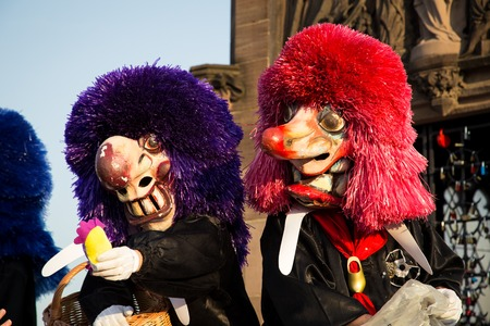fasnacht: Basel, Switzerland - March 10, 2014: Two Waggis at the traditional parade of the annual Basler Fasnacht. Editorial