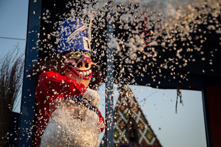 fasnacht: Basel, Switzerland - March 10, 2014: A so called Waggis throwing confetti towards the camera at the Basel carnival.