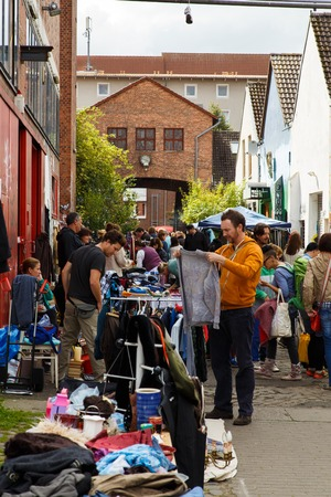rummage: Hanover, Germany - September 14, 2014: People buying and selling things on the weekly flea market at the Kulturhaus Faust.