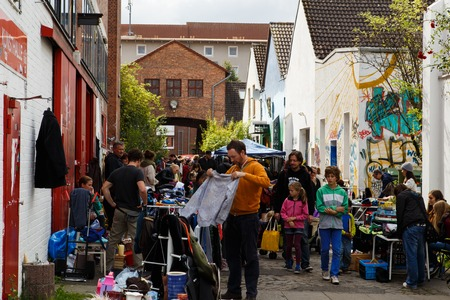 street market: Hanover, Germany - September 14, 2014: People buying and selling things on the weekly flea market at the Kulturhaus Faust.