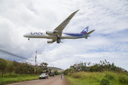 easter island: Easter Island, Chile - December 07, 2015: Photograph of a Boeing 787 Dreamliner landing on Easter Island while people are watching. Editorial