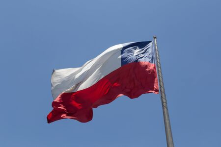 bandera chilena: Photograph of the Chilean Flag blowing in the wind.