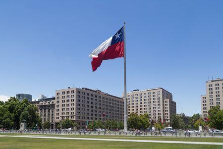 chilean flag: Santiago de Chile - November 26, 2015: Photograph of the huge Chilean flag in front of the Palacio de la Moneda.