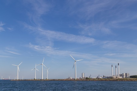 green footprint: Photograph of wind power plants and industrial buildings in Copenhagen, Denmark.