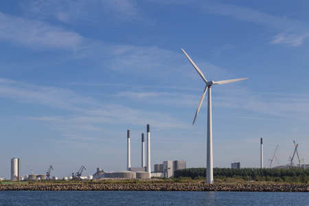 clean energy: Photograph of wind power plants and industrial buildings in Copenhagen, Denmark.