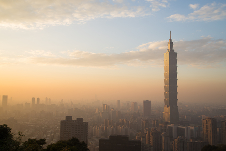 Photograph of Taipei city skyline in Taiwan during sunset. Stock Photo