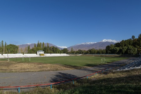 soccer pitch: Soccer pitch and snow capped mountains in Toktogul, Kyrgyzstan.
