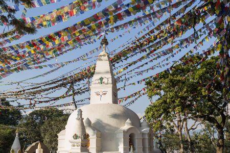 buddhist stupa: Small buddhist stupa with prayer flags at Swayambunath temple in Kathmandu, Nepal.