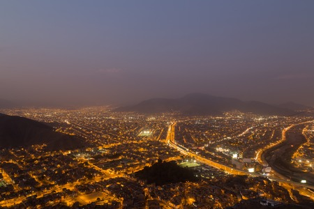 cerro: Panoramic view of the peruvian capital Lima from Cerro San Cristobal by night. Stock Photo