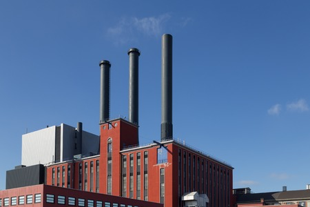 carbon emission: Copenhagen, Denmark - March 17, 2016: Photograph of the H. C. Oersted Power Plant which main task is to supply district heat to Greater Copenhagen.