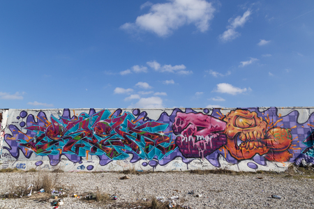 industrial district: Copenhagen, Denmark - March 17, 2016: Graffiti mural in abandoned industrial district.