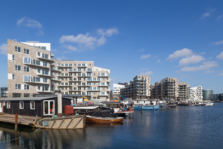 march 17: Copenhagen, Denmark - March 17, 2016: Newly built modern appartments and houseboats. Editorial