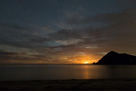 tasman: Moon rising in Abel Tasman National Park, New Zealand