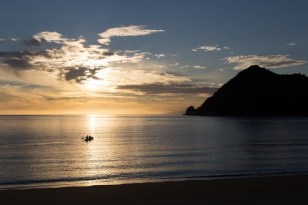 tasman: Kayaking at sunrise in Abel Tasman National Park, New Zealand Stock Photo