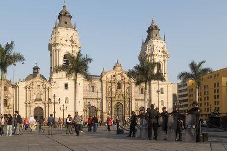 plaza of arms: Lima, Peru - September 17, 2015: Policemen are guarding the central square in front of the cathedral. Editorial