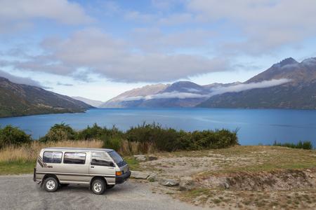 campervan: Wye Creek, New Zealand - March 27, 2015: Campervan in front of Lake Wakatipu on the South Island.