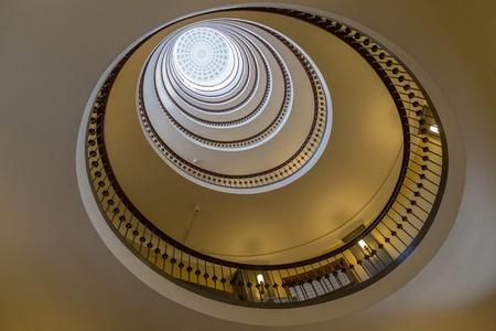 view of an atrium in a building: Copenhagen, Denmark - April 25, 2016: Atrium of the Axelborg Tower Stock Photo
