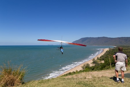 port douglas: Port Douglas, Australia - April 27, 2015: Hang glider starting from from Trinity Bay lookout. Editorial
