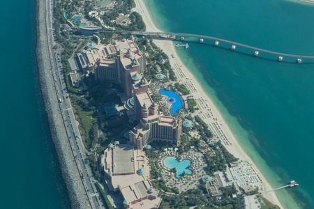 extravagance: Dubai, United Arab Emirates - October 17, 2014: The famous Atlantis The Palm Hotel on the artificial palm island taken from a seaplane.