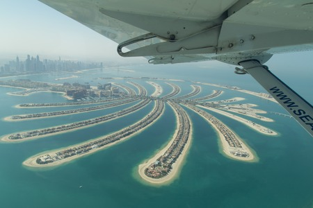 Dubai, United Arab Emirates - October 17, 2014: Aerial view of the artificial island Palm Jumeirah from a seaplane. Editorial