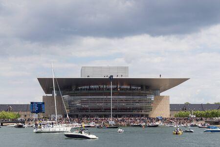 spectators: Copenhagen, Denmark - June 18, 2016: Spectators at the Red Bull cliff diving event at the Opera House.